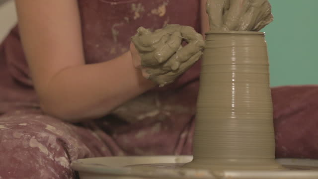 pottery artist making a shape from clay - jug stock videos & royalty-free footage
