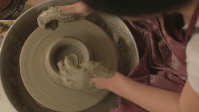 Pottery artist making a shape from clay