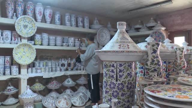 stockvideo's en b-roll-footage met pottery, basketwork and wrought iron furniture pile up in the deserted stalls of the oulja arts and crafts complex in sale near the moroccan capital... - sale