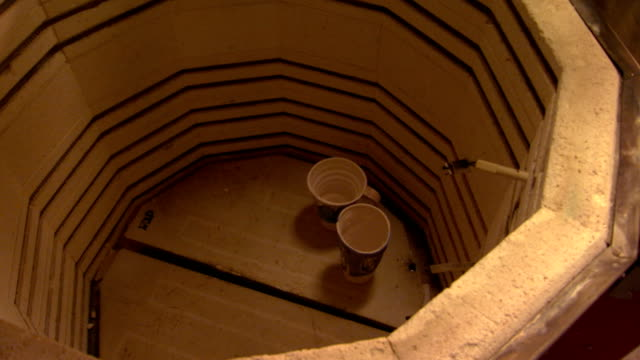 pottery placed in a kiln and the cover closeing - kiln stock videos and b-roll footage