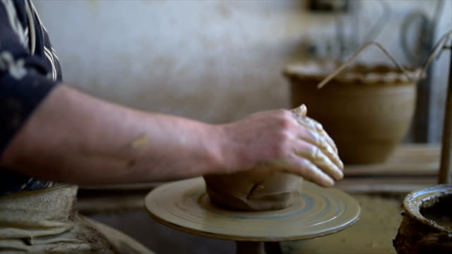 pottery wheel process. close-up - one mature man only stock videos & royalty-free footage
