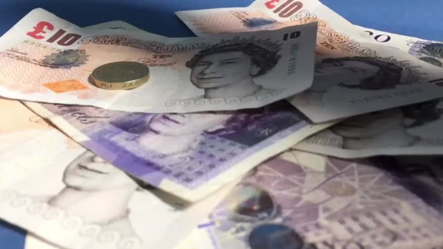 vídeos de stock e filmes b-roll de pound coins and banknotes are seen besides us dollar bills on january 16 2017 in bristol england sterling has dropped sharply following reports that... - european union coin