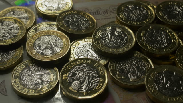 pound sterling coins - british currency stock videos & royalty-free footage