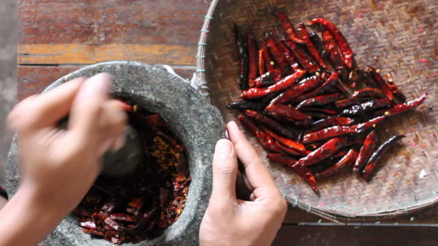 pounding pepper. - mortar and pestle stock videos and b-roll footage