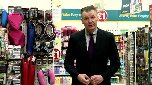 stockvideo's en b-roll-footage met poundland takes over 99p stores; int reporter to camera sot tins of heinz beans adn heinz spaghetti on shelf in poundland store tins of soup for sale... - adn