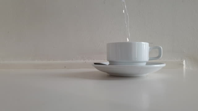 Pour hot water into a cup
