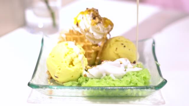 Pour milk on  Ice Cream  mango flavor