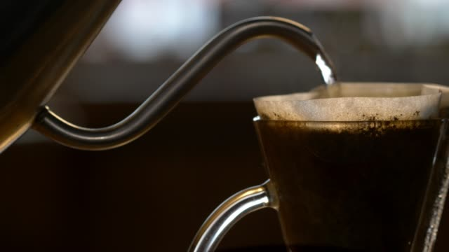 pour over coffee being prepared. - 照明技術点の映像素材/bロール