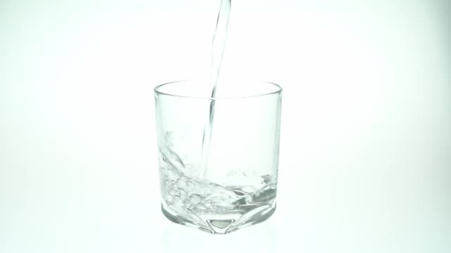 pour water into the glass white background. - square stock videos & royalty-free footage