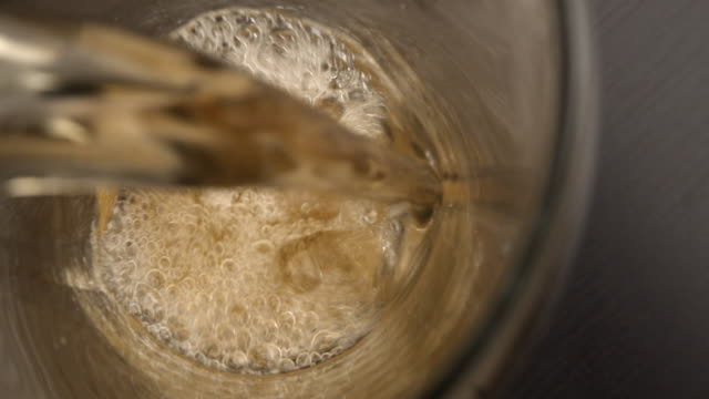 pouring a beer into a glass on the table. - lager stock videos & royalty-free footage