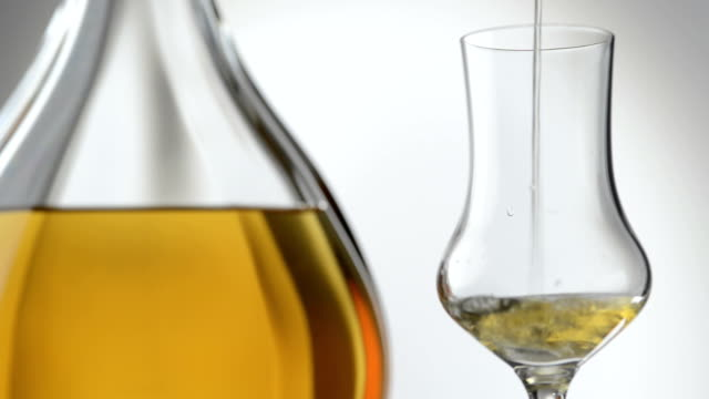 Pouring a class of Grappa or Brandy, HD, Real Time