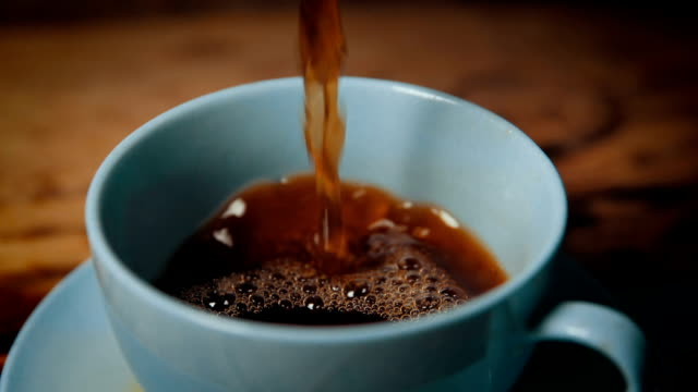 pouring a cup of coffee - tea cup stock videos & royalty-free footage