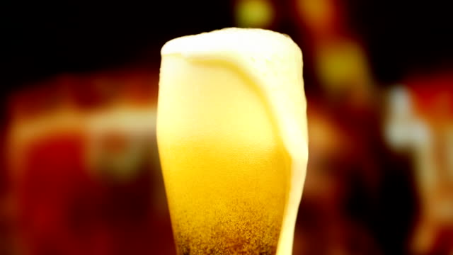 pouring a glass of beer - pint glass stock videos & royalty-free footage