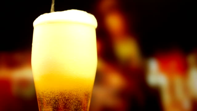 pouring a glass of beer - freshness stock videos & royalty-free footage