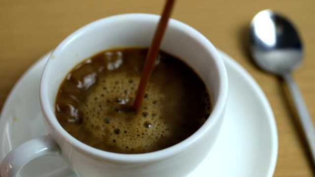 pouring a hot coffee in to white cup on the table. - cup stock videos & royalty-free footage