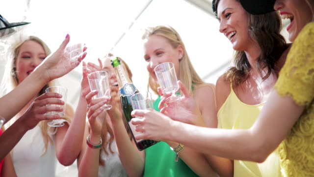 pouring alcohol on ladies day - stereotypically upper class stock videos & royalty-free footage
