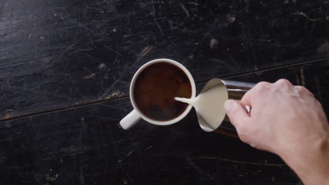 pouring almond milk into fresh hot coffee from above - almond milk stock videos & royalty-free footage