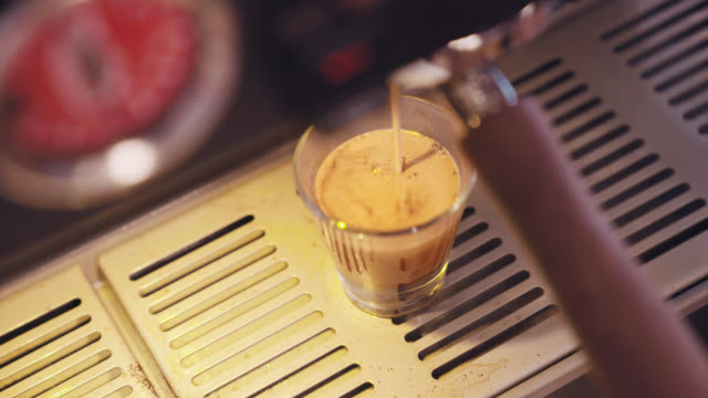 pouring an espresso shot - espresso maker stock videos and b-roll footage