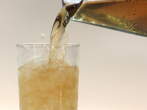 pouring apple juice from a pitcher into a glass with crushed ice - crushed ice stock videos & royalty-free footage