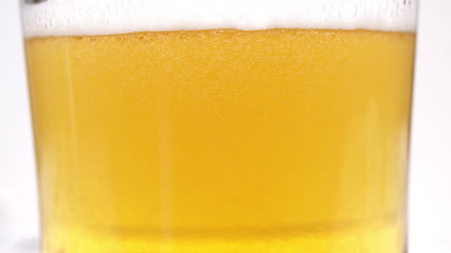 pouring beer in a glass - beer glass stock videos & royalty-free footage