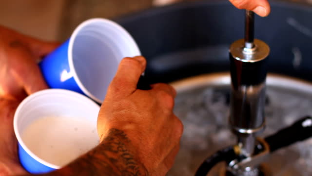 pouring beer in two cups - keg stock videos and b-roll footage