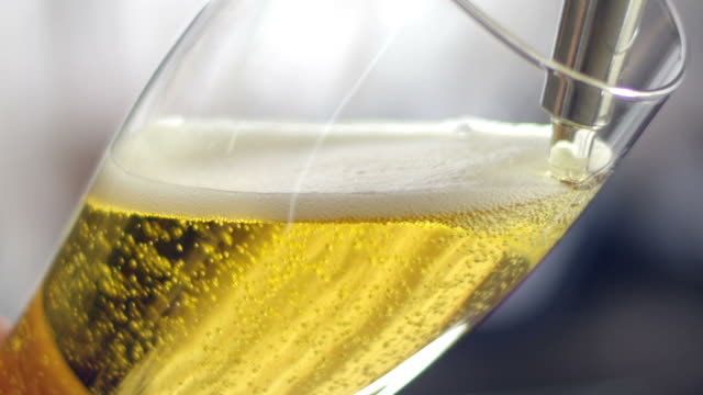 Pouring beer into a glass close-up