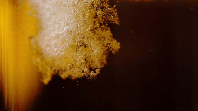 slo mo pouring beer into a glass - pouring stock videos & royalty-free footage