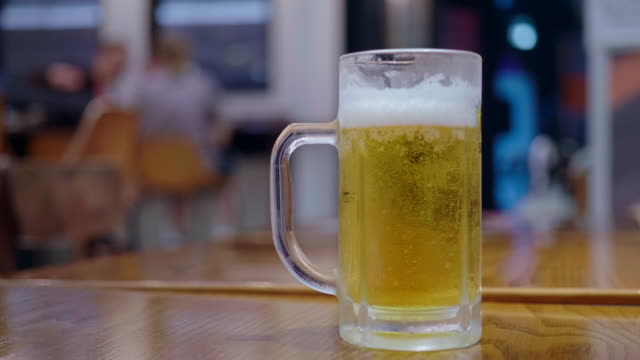 slo mo pouring beer into a glass - beer glass stock videos & royalty-free footage