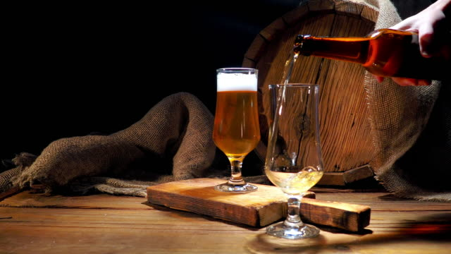 pouring beer next to the barrel - beer glass stock videos & royalty-free footage