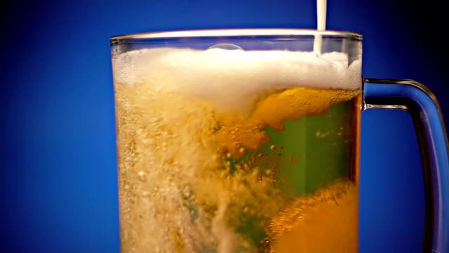 pouring beer - empty beer glass stock videos and b-roll footage