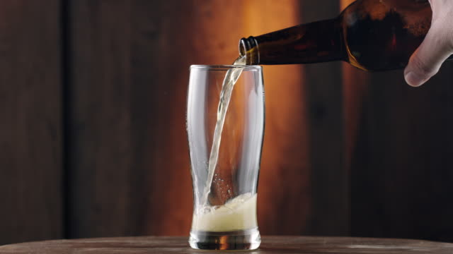 pouring beer - drinking glass stock videos & royalty-free footage
