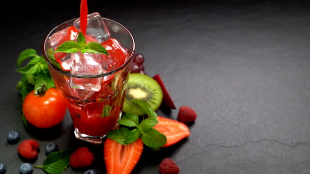 Pouring Beetroot and Berry juice into glass - zoom out