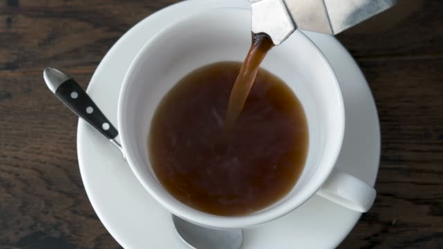 pouring black coffee in cup - saucer stock videos & royalty-free footage