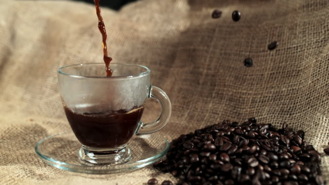 slo mo pouring black coffee - roasted coffee bean stock videos & royalty-free footage