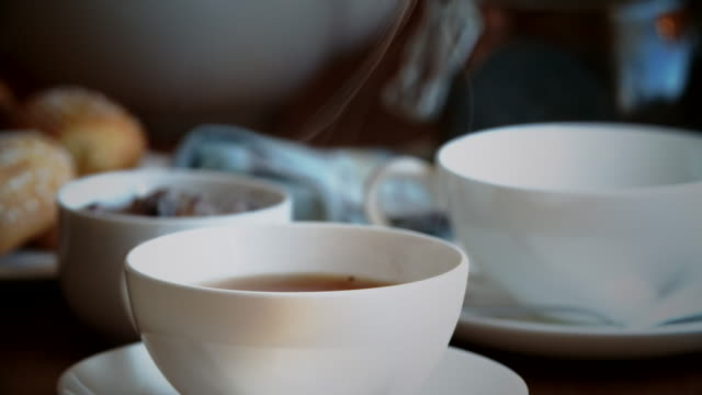 pouring black tea into cup - black tea stock videos & royalty-free footage