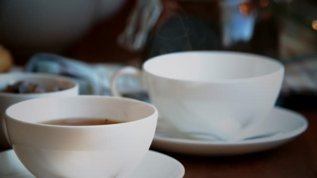 pouring black tea into cup - black tea stock videos & royalty-free footage