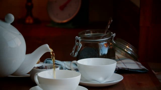 pouring black tea into cup - teapot stock videos & royalty-free footage