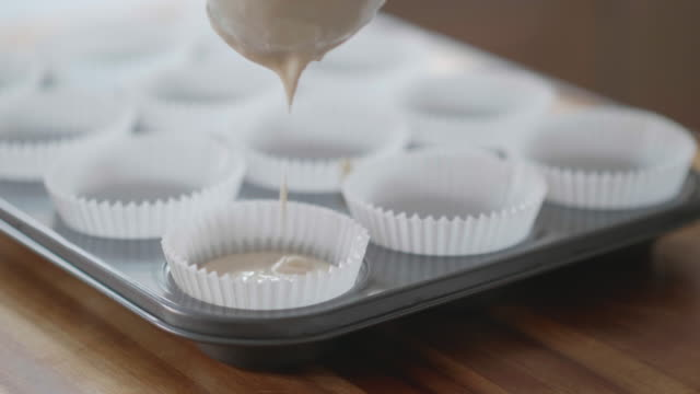 pouring blueberry muffin batter into cup tin - blueberry muffin stock videos & royalty-free footage