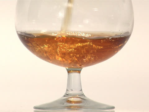 pouring brandy into a snifter, close up - brandy snifter stock videos and b-roll footage