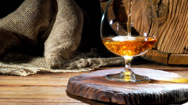 pouring brandy next to the barrel - brandy snifter stock videos & royalty-free footage