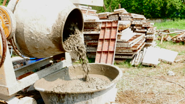 pouring cement from  mixing cement machine - cement mixer stock videos & royalty-free footage