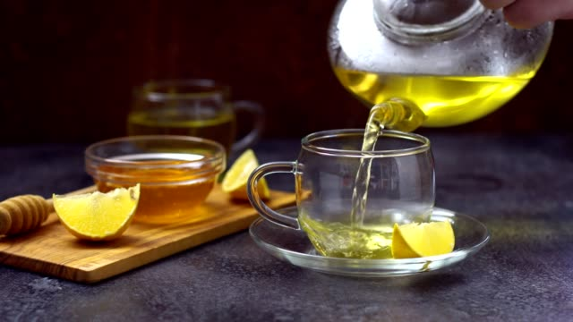 pouring chamomile tea into cup - high tea stock videos and b-roll footage