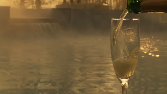 hd slow motion: pouring champagne by the pool - thermal pool stock videos & royalty-free footage
