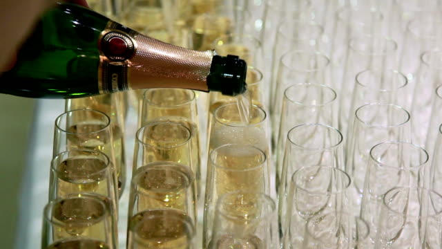 pouring champagne in the champagne flutes - champagne stock videos & royalty-free footage