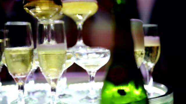 pouring champagne into a glasses - group of objects stock videos and b-roll footage