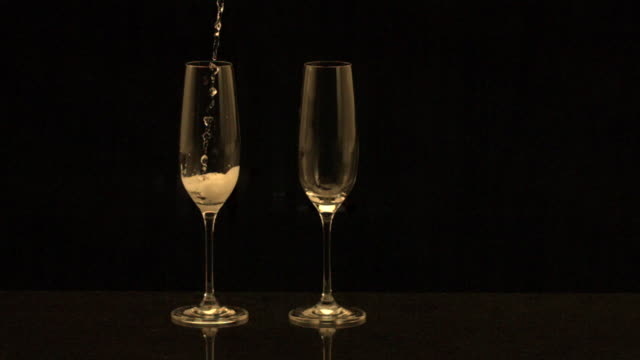 pouring champagne into champagne flute (slow motion) - 1 minute or greater stock videos & royalty-free footage