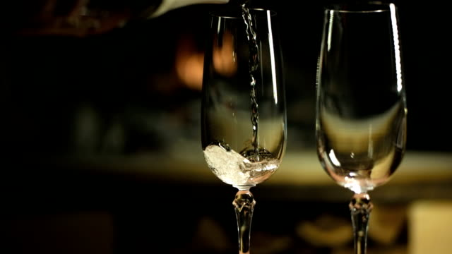 hd dolly: pouring champagne into glasses - champagne stock videos & royalty-free footage