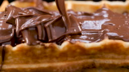 Pouring chocolate spread on to the waffles - sliding shot