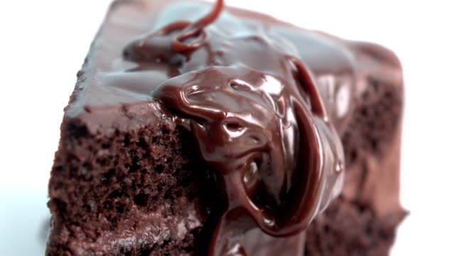 4K pouring chocolates on chocolate cake