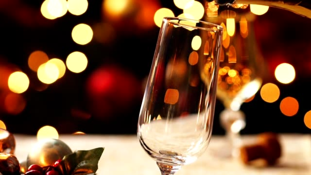 pouring christmas champagne - champagne flute stock videos & royalty-free footage